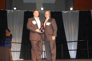 HG receiving award